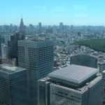 View across town to Tokyo Bay and Odaiba. The greenery is part of Meiji Jingu.