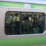 Crowded Yamanote Line train. If you can't get on, next is in 2-3 minutes.