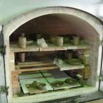 Preparing the kiln for firing.
