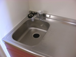 Sink in kitchen. Usually a little small, to create more space for chopping board etc.